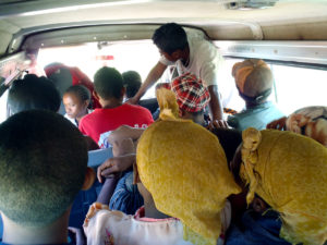 This is from inside the taxi-brousse we were on when we went to our friend's village. You can't really see all the people in front (because the lens isn't wide-angle enough), but you can see they're packed in tight! And this was still several people before it was full – at that point I couldn't move my arms around well enough to get a good picture!