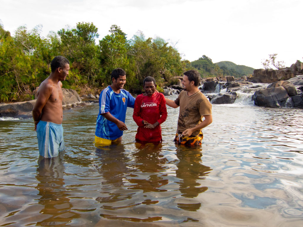 Baptizing the first new believer in Antenina - new life!