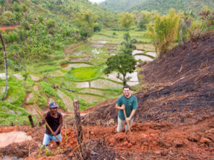 Working together to terrace a new ricefield with one of the guys in one of the Bible study groups.