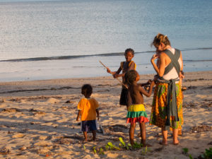 Lora and Matimu playing with some kids on our first visit to Nosy Mitsio