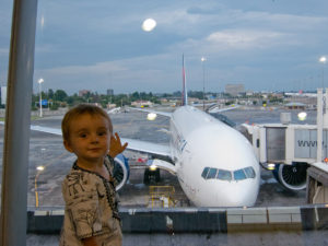 Matimu at the airport, waiting to fly on a trip from South Africa to the US. Matimu LOVES airplanes!
