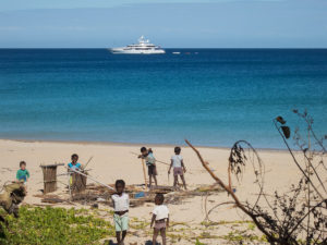 Some sort of large cruise ship that passed by Nosy Mitsio several times, while the kids (including Matimu) were using leftover construction materials to build their own houses on the beach.