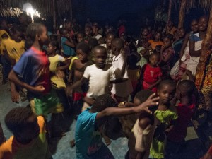 Some of the kids having a great time dancing to the lights and music powered by a visitor's generator during the first night of the ceremony.