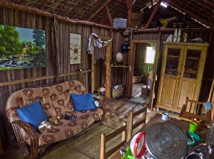 The main room of our home on Nosy Mitsio, with our surviving cat asleep on the couch.