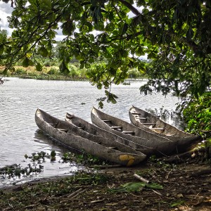 Madagascar 4 photos - fishing canoes on the Pangalanes river