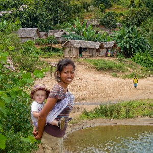 Madagascar 5 photos - our friend Njara helping carry Matimu on the long hike out to Antenina Village
