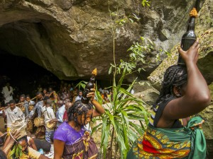 "Antakarana people presenting offerings to their ancestors at the royal cave, during the time the ""doors are open."""