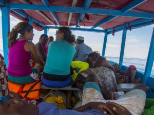 Some ladies on our team talking and spending time with ladies from our island while on our boat to mainland Madagascar.
