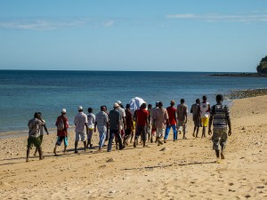 A funeral on Nosy Mitsio - the young men carrying the body across the island to the burial ground.